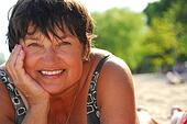 Mature woman beach. Fotosearch EnhancedRF Royalty Free