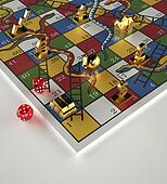 Tokens and dice on Snakes and Ladders game