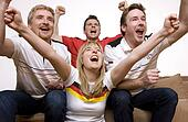 Soccer Fans watching Soccer Game on Television